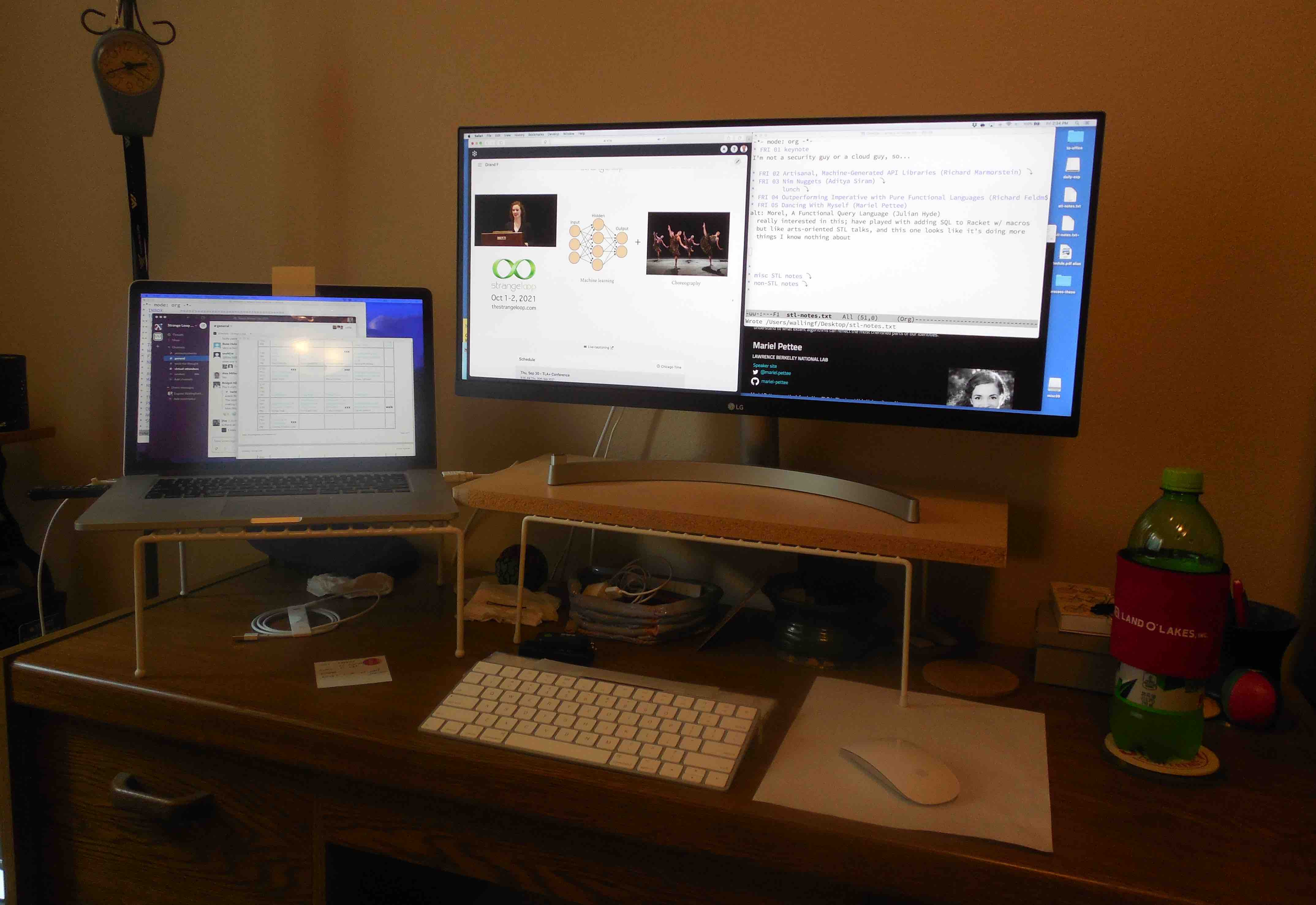 my Strange Loop 2021 home set-up, with laptop on the left, 29-inch monitor in the center, and a beverage to the right