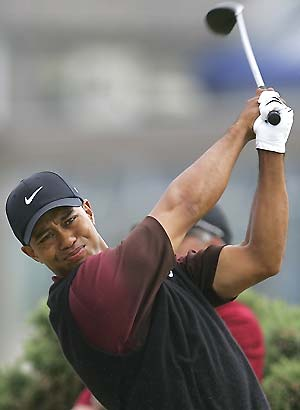 Tiger Woods drives a ball