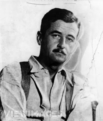 novelist William Faulkner, dressed for work