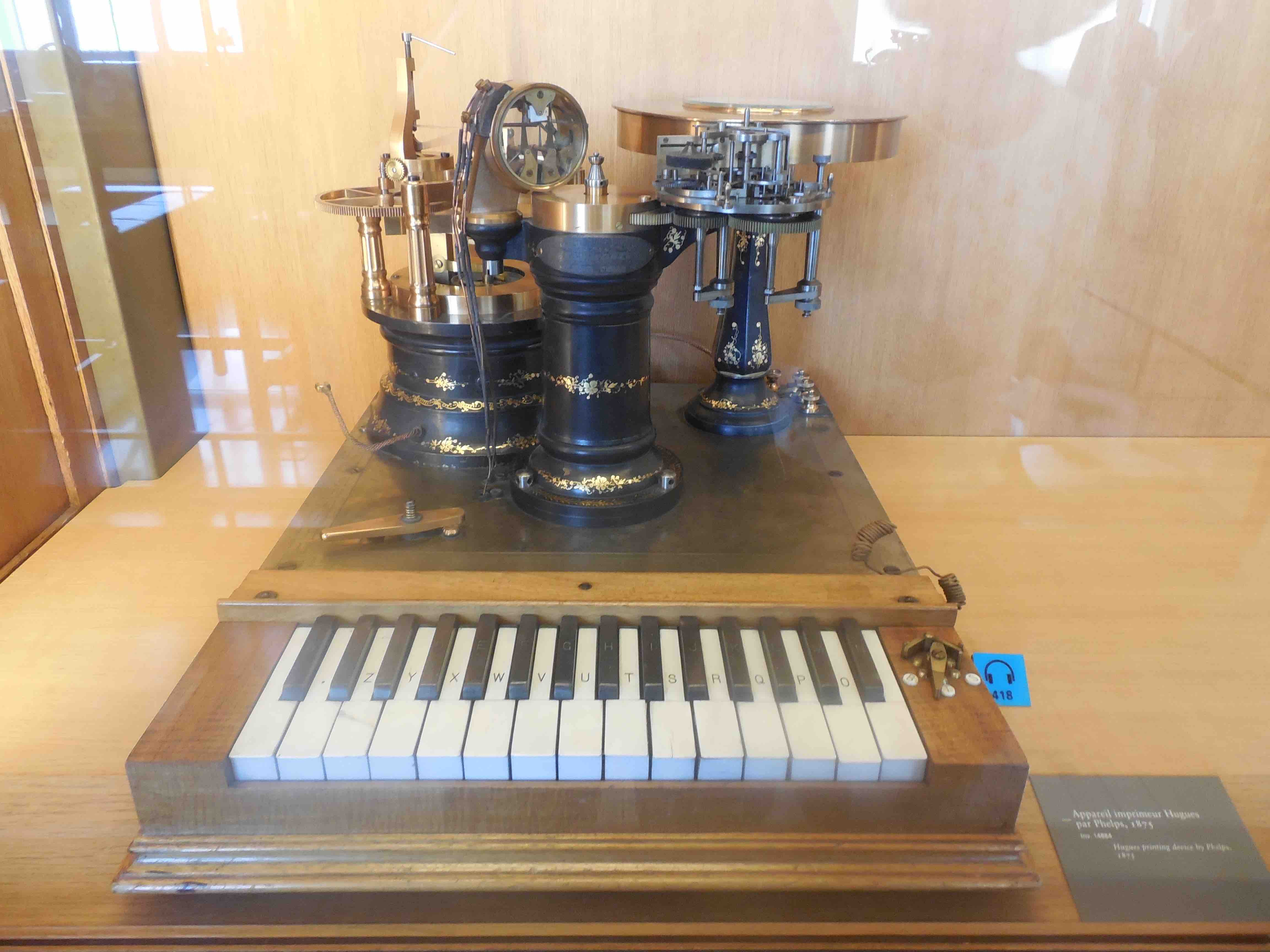 a Hughes teleprinter with piano-style keyboard, circa 1975, in the CNAM museum, Paris